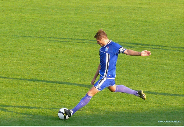 A footballer running on the field